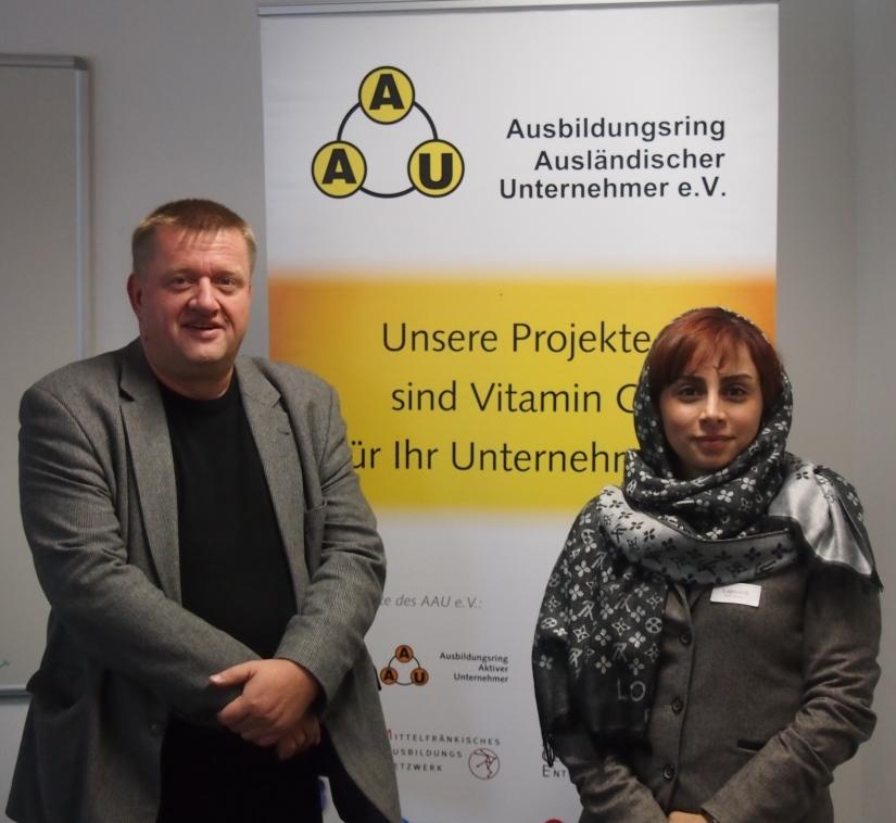 Frau Lajevardi mit dem XeneX Senior Consultant Rainer Aliochin (AAU e.V.)